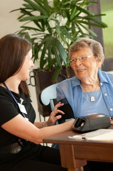 Home Care nurse with a telemonitoring patient