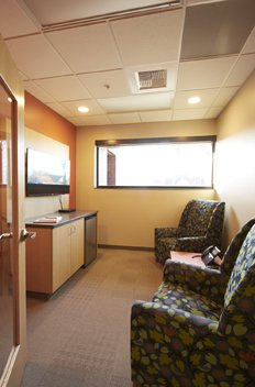 Hospitality Suite provides a space for a care receiver to comfortably wait for their caregiver, within view of the office coordinator, or a place for a caregiver to relax.