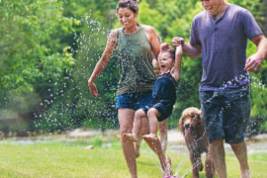 family in sprinkler