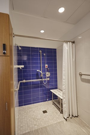 "Each room has its own spacious bathroom, with a ""curbless"" walk-in shower."