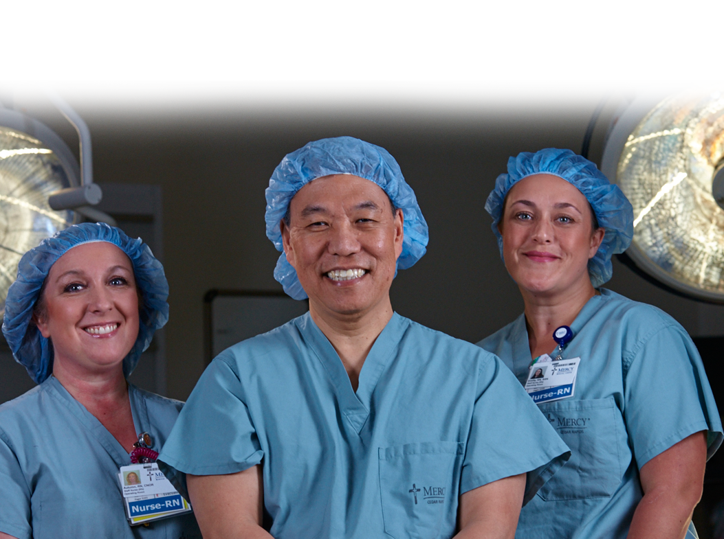Mercy Cardiothoracic Surgeon, C. C. Lee, MD, with staff