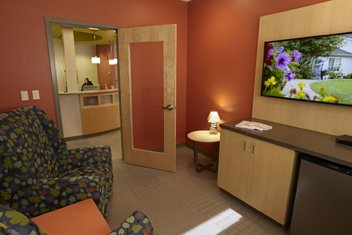 Hospitality Suite provides a space for a care receiver to comfortably wait for their caregiver, within view of the office coordinator.