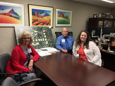 """At one time, there were five of us here,"" said Janelle (right), of her family's ties to Mercy. ""We've always joked that we were a Mercy family."" She and her parents, Jo Ellen (left) and Mark (center), all work at Mercy. Jo Ellen, Director of Health Information Management, joined Mercy almost 32 years ago. At the time, her sister worked here as well. A few years later, Jo Ellen heard about an opening for an electrician in the Facilities department. Mark was hired and held that position for his first 10 years at Mercy; he's been the Facilities Supervisor for the last 19 years. When she was young, Janelle was a candystriper at Mercy. She remembers riding into the hospital at 5:30 a.m. with her parents to volunteer. Her grandma, Mark's mom, also volunteered at the time. At Mercy for almost 16 years, Janelle is now a shift supervisor on the Behavioral Health Unit and access nurse, which means she provides consultations for mental health and substance abuse patients throughout the hospital, ER and clinics. What a family legacy."